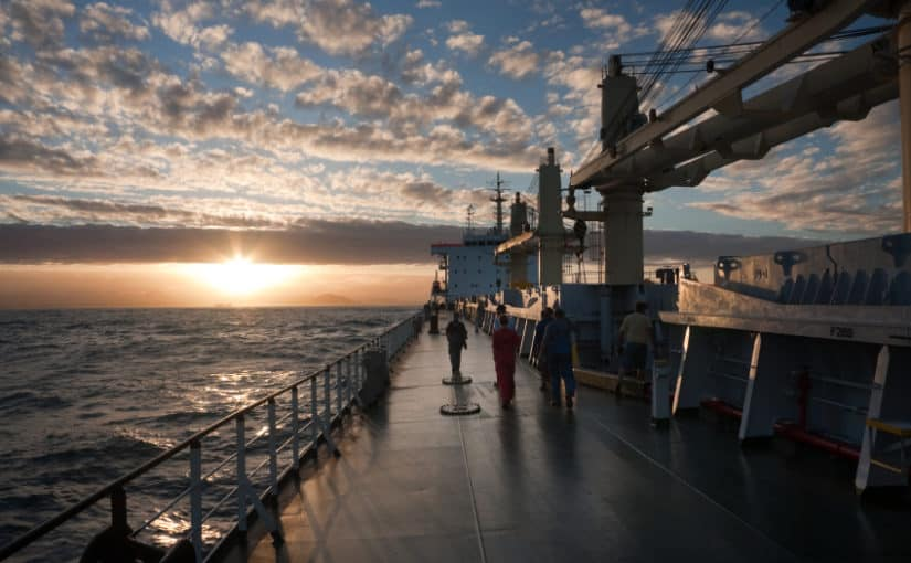 Sailors go back to the superstructure after work in cargo ship